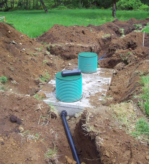 A 2 compartment septic tanks installed for a gravity septic system.