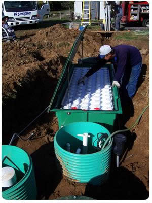 An Advantex AX-20 fabric filter being installed on a site with marginal soils.