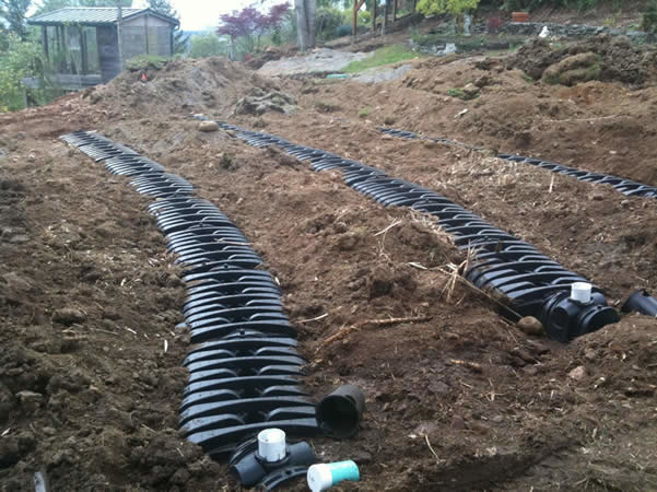 Multiple graveless chamber laterals installed as part of a complete pressurized drainfield system.