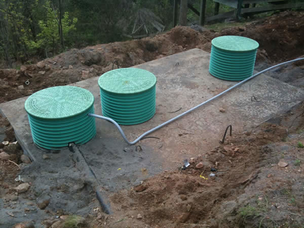 A 3 compartment tank being installed for a pressure distribution system.